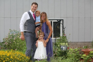 Adam, Kristin, Briggs, and Harper all dressed up for the party