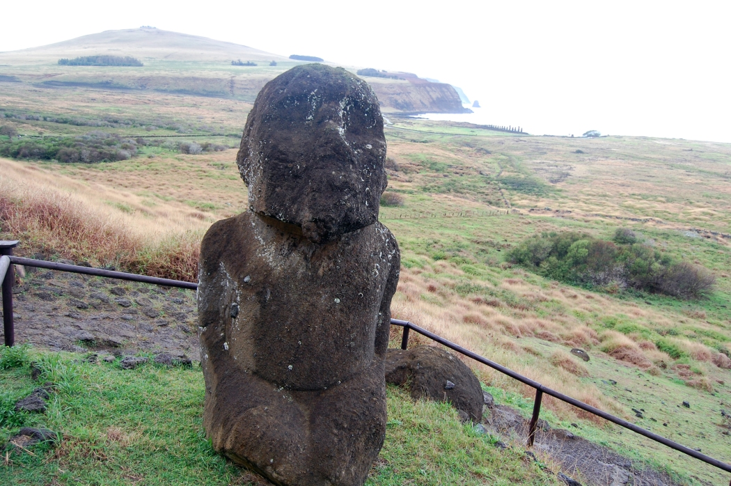Tukuturi statue at the top of the hill.  The statue is of a kneeling hermaphrodite, and you can see remote Poike Peninsula and Ahu Tangariki in the background